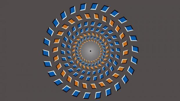 Fije la vista en el punto negro y mueva su cabeza hacia atrás y hacia delante para percibir los anillos girando